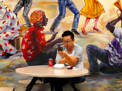 Canada: Toronto St. Lawrence Market (Henk Binnendijk) Tags: canada toronto ontario stlawrencemarket foodcourt lunch people candid phone cellphone gsm eating food mural cocacola