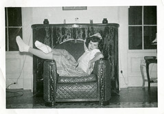 Girl in Chair before Fireplace Mantel, 1950s (StevenM_61) Tags: teenagegirl socks chair mantel 1950s