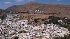 View of the village of Lindos from Acropolis on Rhodes Island (kasiaczn) Tags: europe greece rodos lindos island country place sky view front ebav houses white mountains rocks village summer travel turist tourist visit nature landscape photo image