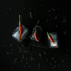 Week 45 - Artistic: Cold (Melting) (Ben Aerssen) Tags: cold frozen wet chilies peppers chili ice water cube freeze melt melting melted three red green blue black contrast light stilllife reflection vegetables white drops multiple