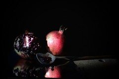 When You Can't Look on the Illuminated Side, I Will Sit With You in the Dark Side ... (Đøn@tus ♠) Tags: stilllife lowkeyphotography lightsandshadows lowkeyphoto naturamorta fruit pomegranate lightanddarkness reflection chiaroscuro tenebrism