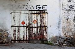 The way I feel... (Jean-Luc Léopoldi) Tags: vieillesse vieilleville portes garage flakingoff decay décrépi abandonné mur old
