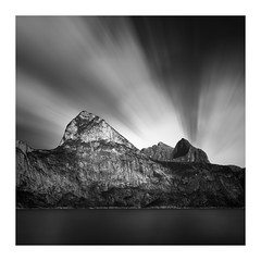 The Madonna of the mountain (Andreas Larzon Photography) Tags: andreaslarzon bw blackandwhite calmwater cloudtrails coast glasswater harshlight landscape landscapephotography lightrays midday mirrorwater mountain mountainlandscape nikond7200 norway ocean patternsandtextures sea seascape serene shoreline sigma24105mmf4dgoshsmart smoothwater seaside mefjordvaer