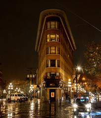 Retro glimpse c. 1908 (Christie : Colour & Light Collection) Tags: canadianhistory history waterstreet vancouver hoteleurope bc canada night retro antique flatironstylebuilding building gastpwn vancouvercore cobblestone nightphotography ghost haunted ghoststory brothel bronze