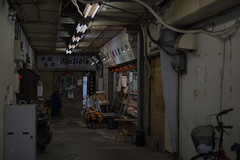 meat shop in the cave (kasa51) Tags: meatshop butcher inside backward dim people street tokyo japan sign alley