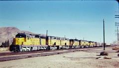 Union Pacific SD24 DD35B SD40-2 and GP30B locomotives on a freight at Yermo California in 1977 (Tangled Bank) Tags: train trains railway railways railroad railroads old classic heritage vinyage california vintage north american motive power 1970s 70s