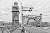 Saint Petersburg, Russia. A tower and an arch of Bolsheokhtinsky bridge. (g_reg_walker) Tags: saint petersburg russia architecture construction building perspective metal iron transport road highway autumn fall bad weather grey sky gloomy neva river sights sightseeing tower arch traffic brick black white desaturated bridge cityscape excursion fence historic historical landmark pavement peter great rivet steelwork tourism trip