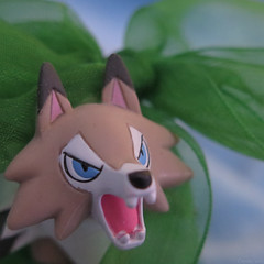 The buttons would be pushing it... (Coyoty) Tags: macromondays buttonsandbows bow christmas decoration color lycanroc pokemon action figure actionfigure square squareformat christmasbow green brown blue anger macro bokeh texture ribbon toy fox coyote teeth eyes