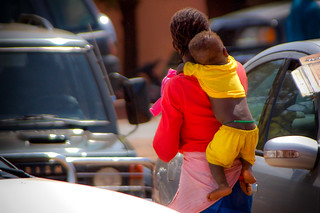 Baby in Mali hanging off his mother without any support
