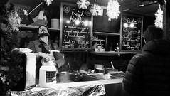 festive market at night 04 (byronv2) Tags: festive festivemarket christmasmarket peoplewatching candid street princesstreet princesstreetgardens edinburgh edimbourg edinburghbynight night nuit nacht blackandwhite blackwhite bw monochrome market mound