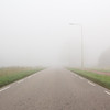 Misty morning (Bregg) Tags: mist polder netherlands zeeland sluiskil road lamppoles landscape minimal