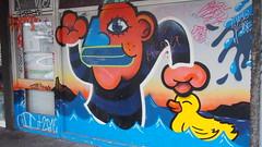 Back Alley Rubber Ducky Assault (stephenweir) Tags: rubberducky streetart streetphotography bluelips cartoon funnyshit strange backalleymural graffiti iceland reykjavik