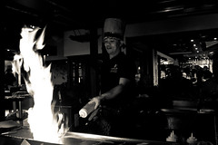 Fiery Creation (The_Kevster) Tags: chef teppanyaki restaurant cook japanese food cyprus coralbay monochrome bw blackandwhite europe dslr nikon nikond3300 attraction heat flame fire hat hotplate samisen holiday