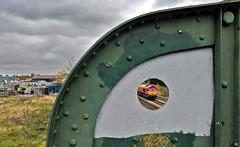 Through the Round Window at Burton (robmcrorie) Tags: 66136 class 66 burton trent staffordshire brewery footbridge 6x01 scunthorpe eastleigh rails rail railway train freight nikon d7500