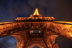 Effiel Tower (updownmo) Tags: symbol photo photography nightphotography structural architecture paris clouds sky effieltower love beautiful engineering view lines lit image lookingup nightphoto adventure cloudysky structure curves arch history historical sign symmetry symmetrical height