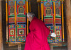 Tibetan monk turning huge prayer wheels in Labrang monastery, Gansu province, Labrang, China (Eric Lafforgue) Tags: 6065years amdo asia asian buddhism buddhist china china17477 clergy colourimage community cultures day gannantibetanautonomousprefecture horizontal inarow khor kora labrang labulengsi largegroupofobjects lifestyles maniwheel monastery monk onepersononly placeofworship prayerwheels religion religious religioussymbol spirituality symbolsofpeace temple tibet tibetan tibetanethnicity touristdestination tradition traditionalclothing traditionallytibetan tranquility typical waistup worldtravel xiahecounty gansuprovince chn