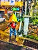 Jamaica Rainy Day!.  But on the positive side, the raindrops on the vehicle window gives this image an artistic effect. (ArtsySF©Marjie) Tags: oceaniacruises cubajamaicabahamascruise yellowumbrella yellow downpour jamaica portantonio window raindrops rainy umbrella street man