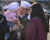 Sailor meets his daughter for the first time. (Official U.S. Navy Imagery) Tags: ussnimitz cvn68 aircraftcarrier usnavy deployment pacificocean coronado calif unitedstates