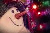 Christmas With Snowlady (Wes Iversen) Tags: christmas christmasdecorations christmaslights clichesaturday grandblanc hcs hsos macros michigan odc ourdailychallenge smileonsaturday tokina100mmf28atxprod xmasdeco flare painterly snowlady