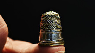 thimble on the fingertip