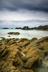 Mellow Yellow Barnacle Heaven. (Andy Bracey -) Tags: bracey andybracey atlantic ocean cornwall fistral fistralbeach newquay beach rocks mellowyellow barnacleheaven mellowyellowbranacleheaven coast coastal longexposure bigstopper leefilters landscape landscapephotography seascape stormy typicalholidayweather holidays britishsummertime