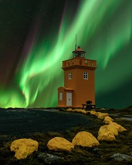 Lighthouse (vaibhav.pandeys) Tags: polarlights lights greensky astrography longexposurephotos mystopover inspiredbyiceland flickr awesomeearth worldaurora exploreiceland iceland travel nature lighthouse longexposure astrophotography nightphotography northernlights auroraborealis aurora