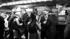 festive market at night 05 (byronv2) Tags: edinburgh edinburghbynight night nuit nacht festivemarket christmasmarket market princesstreetgardens princesstreet mound newtown blackandwhite blackwhite bw monochrome peoplewatching candid street winter stall shop shopping food drink drinking