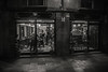 NIght cutters...... (Dafydd Penguin) Tags: hairdresser barber night cutters salon raw street candid shot after dark shots urban city town centre barcelona catalunya catalonia spain blackandwhite blackwhite black white monochome mono noir scene life men women bw nikon df nikkor 20mm af f28d