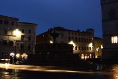 Perugia carlights around the fountain (moniq84) Tags: perugia umbria fontana maggiore carlights lights lamps night nightphotography blue hour people rainy day fountain piazza iv novembre water winter long exposure city streets