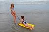 Pulling Carolina (Joe Shlabotnik) Tags: july2017 higginsbeach boogieboard violet 2017 maine carolina ocean beach afsdxvrzoomnikkor18105mmf3556ged faved