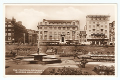 Manchester - Piccadilly Gardens and Fountain in 1955 (pepandtim) Tags: postcard old early nostalgia nostalgic manchester piccadilly gardens fountain photograph 1955 floral display 1855 anonymity 34mpg52 woolworth store monument queen victoria onslow ford