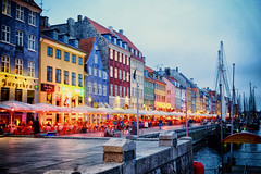 Early evening in Copenhagen, Denmark (` Toshio ') Tags: toshio denmark copenhagen europe nyhavn restaurants cafe bar dock harbor boat mast tallships people european europeanunion bicycle ship bike colorful fujixe2 xe2