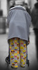 Old woman wearing Flashy Pants (TheMachineStops) Tags: 2017 outdoor nyc newyorkcity manhattan 14thstreet emojis blur bokeh walker person emoticons