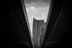 Under the Bridge (SawardPhotography) Tags: singapore bw street bridge tunnel light dark building