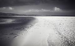 Sandyhills Beach (TrotterFechan) Tags: sandyhills beach sand clouds black white seascape