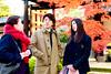 Nice family watching autumn leaves at Gotokuji (Dakiny) Tags: 2017 winter december japan tokyo setagayaward gotokuji city street temple gotokujitemple autumnleaves autumncolors maple red bokeh