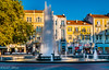 Tango of Light & Shadows - Plovdiv, Bulgaria. (Khalid H Abbasi) Tags: fountain townsquare stefanstambolovsquare plovdiv bulgaria longexposure travel photography rooftops shadows tree nikond5500 nikon tamron tamronaf18270mmf3563diiivcpzdb008n ndfilter blue yellow