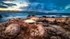 Ones in a dramatic Sky (Vee | Exposed) Tags: landscape sunset veeexposed formation fall orange sea mediterranian blue longexposure winter cloud sunrise talgħażżenin malta seascape morning clouds sky rocks