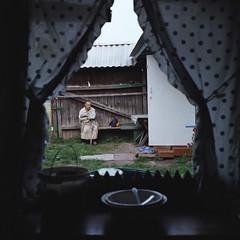 Upset (Anton Novoselov) Tags: russian village babushka old woman бабушка деревня россия film russia nature ural alone place kodak medium format 6x6 120 square watch point temnovka пленка indoor русская outdoor portrait bench лавка скамейка grass ограда двор rolleiflex tlr xenotar 35