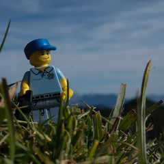 looking for a motive (genelabo) Tags: lego minifigure photo photographer gene sony genelabo rotwand bayern bavaria sun sunny sonne sonnig spitzing mangfallgebirge spitzingsee hiking wandern blue blau grass gras mountains berge taubenstein deutschland sky himmel photographical