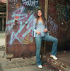 Giulia 8 A (neohypofilms) Tags: portrait gritty color hippie retro 70s blue colours graffiti shoes clogs mules socks stockings jeans denim paint hair tall long rust urban hasselblad art city cleveland medium format 120