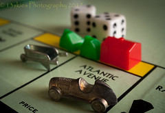 The Player (HMM) (13skies) Tags: gameorgamepieces pieces monopoly atlanticavenue dice houses apartments roll money macro macroscopic economics car wheelbarrow moves buy sell friends hmm macromondays happymacromonday sonyalpha100 sony