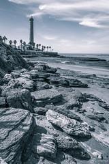 Punta del Perro Light (Benedikt Filip) Tags: sand landschaft himmel andalusien natur leuchtturm felsen ausen strand wolken monochrom tag teiltönung meer weitwinkel wasser spanien bucht