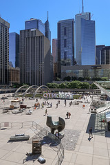 Excellent view of surroundings ill-suited to a 1966 Henry Moore bronze abstract sculpture. (Tim Kiser) Tags: 1960s 1960sartwork 1960ssculpture 1966 1966artwork 1966sculpture 2016 20160924 canada henrymoore henrymooresculpture img3216 nathanphillipssquare ontario september september2016 thearcher threewaypieceno2thearcher threewaypieceno2archer toronto torontocanada torontocityhall torontoontario torontoontariocanada torontosign abstractsculpture bronzesculpture cloudlesssky distantfountain downtown downtowntoronto fountain outdoorsculpture people plaza publicart publicsculpture sculpture skyscrapers southontario southernontario sunny temporaryfences temporaryfencing