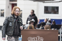 Cafe exile (Frank Fullard) Tags: frankfullard fullard candid street portrait cafe galway irish ireland leather chain ink red hair beard inked tattoo face listen music ipod wired pierced piercing nose