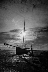 Stranded (selvagedavid38) Tags: wreck tide abandonded essex heybridge maldon black white monochrome sun backlit light sky clouds rope mooring mudflats canon 70d tripod