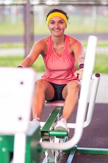 Sport Concepts.One Happy and Positive  Caucasian Female Athlete in Good Fit Having Training For Legs and Arms Muscles Outdoors.