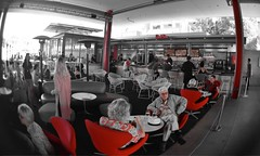The Red Patio (MPnormaleye) Tags: distorted blur selectivecolor red cafe urban fisheye wideangle seeinanewway lensbaby utata