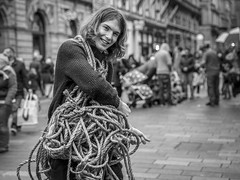 A Frayed Knot (Leanne Boulton) Tags: urban street candid portrait portraiture streetphotography candidstreetphotography candidportrait streetportrait eyecontact candideyecontact streetlife man male eyes face facial expression smile smiling look emotion feeling mood rope knot ties performance art tone texture detail depthoffield bokeh naturallight outdoor light shade shadow city scene human life living humanity society culture people canon canon5d 5dmkiii 70mm ef2470mmf28liiusm black white blackwhite bw mono blackandwhite monochrome glasgow scotland uk