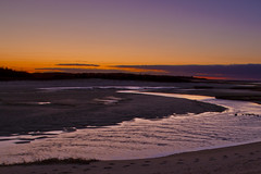 River Mouth at Sunset (brucetopher) Tags: water stream brook tide flats beach sea ocean sunset sky purple yellow ornage red glow twilight evening winter fall changeofseason seasons seasonal season cold night nightfall flow current ripples drain drainage lowtide low cloud afterglow peace peaceful melancholy